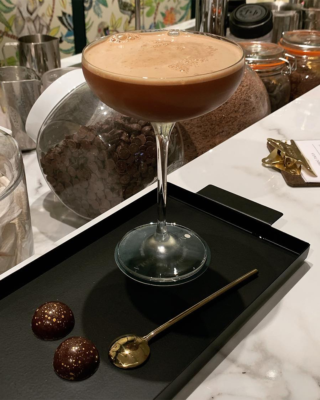 A hot chocolate looking classy in a tall glass at the chocolate bar at Commercial bay's Honest Chocolat.