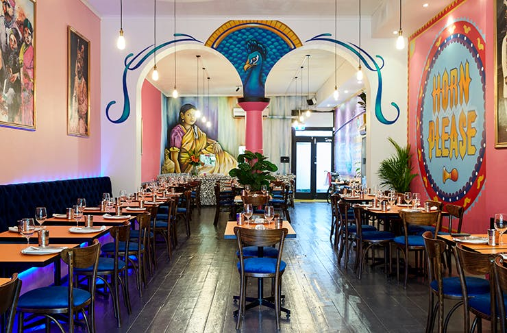 The colourful interior of Indian restaurant Horn Please.