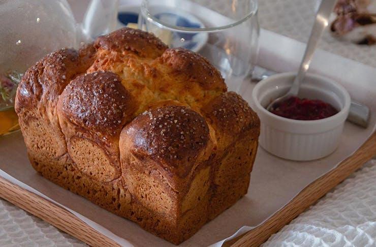 A freshly baked gluten free brioche bun from Hotel Windsor.