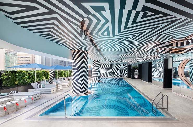 w Brisbane's undercover pool, with a roof covered in zig zagging black lines