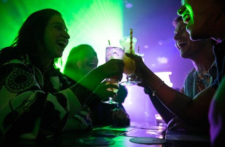 Friends cheers at Universal nightclub in Sydney