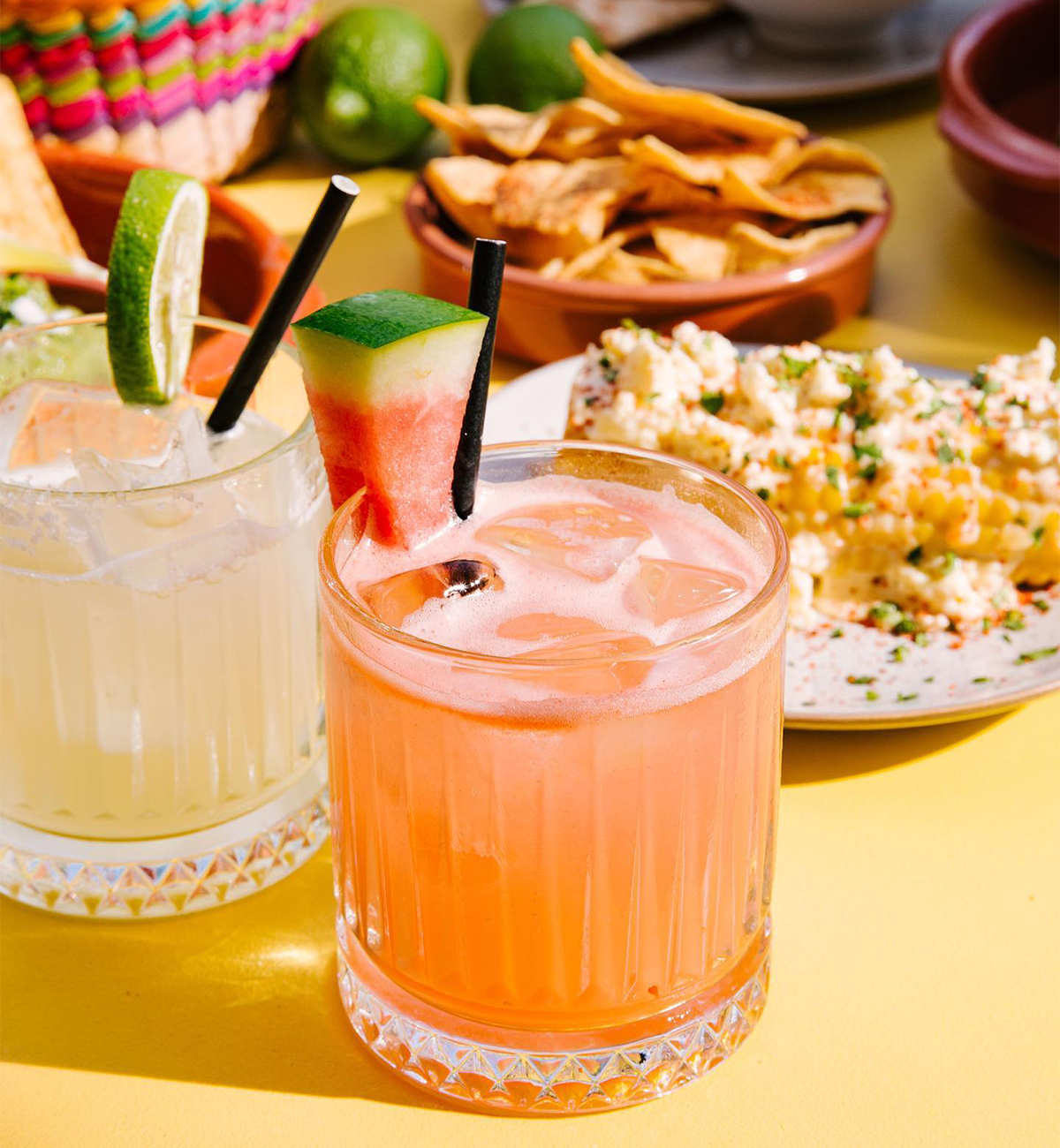 mexican dishes and margs on a table