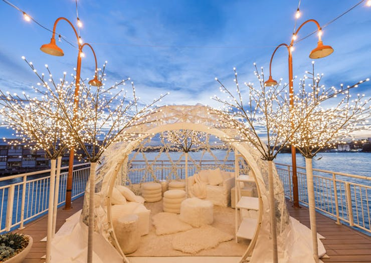 The pop-up igloo suite at Pier One hotel in Sydney, with Walsh Bay and the sunset in the background.