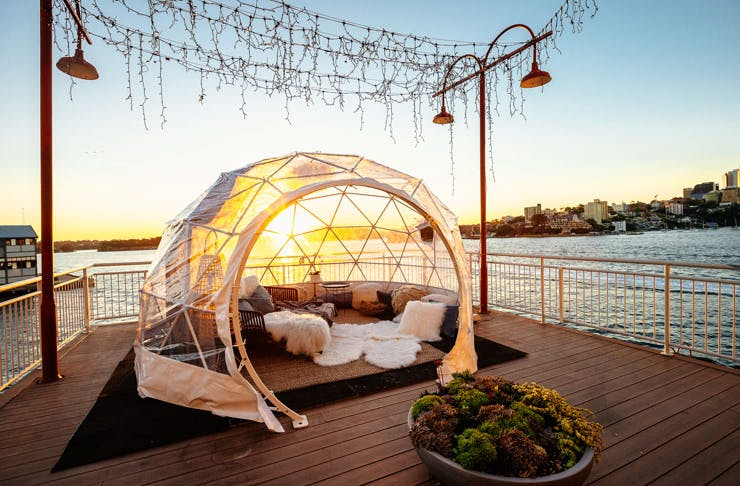 The igloo lounge set up on the harbourside balcony of Pier One Sydney Harbour Hotel.
