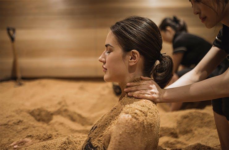 A woman enjoys an enzyme treatment at Ikoi Spa