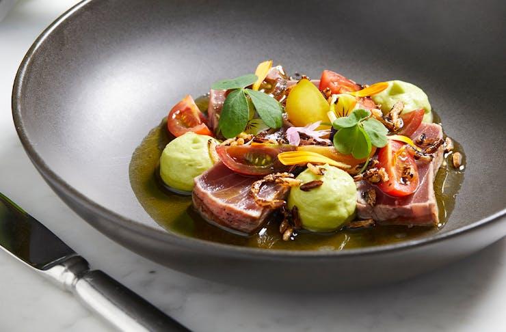seared tuna and fresh produce in a bowl