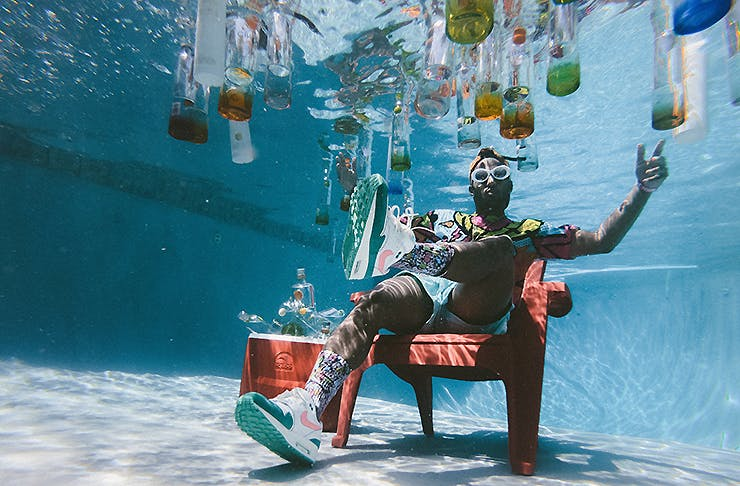 A guy sitting in a swimming pool, Things to do in Auckland this month