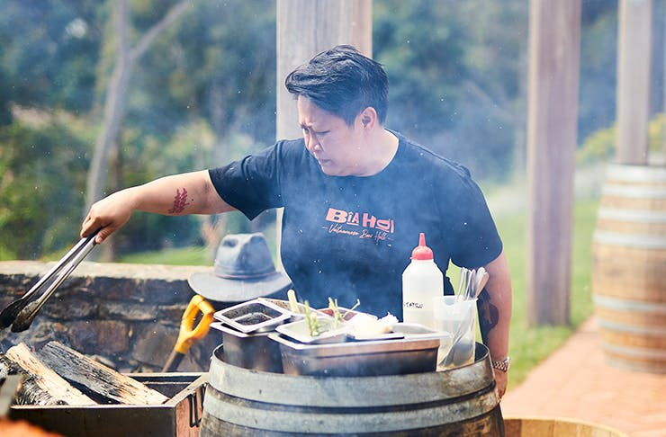 Chef Jerry Mai cooking on an outdoor bbq.