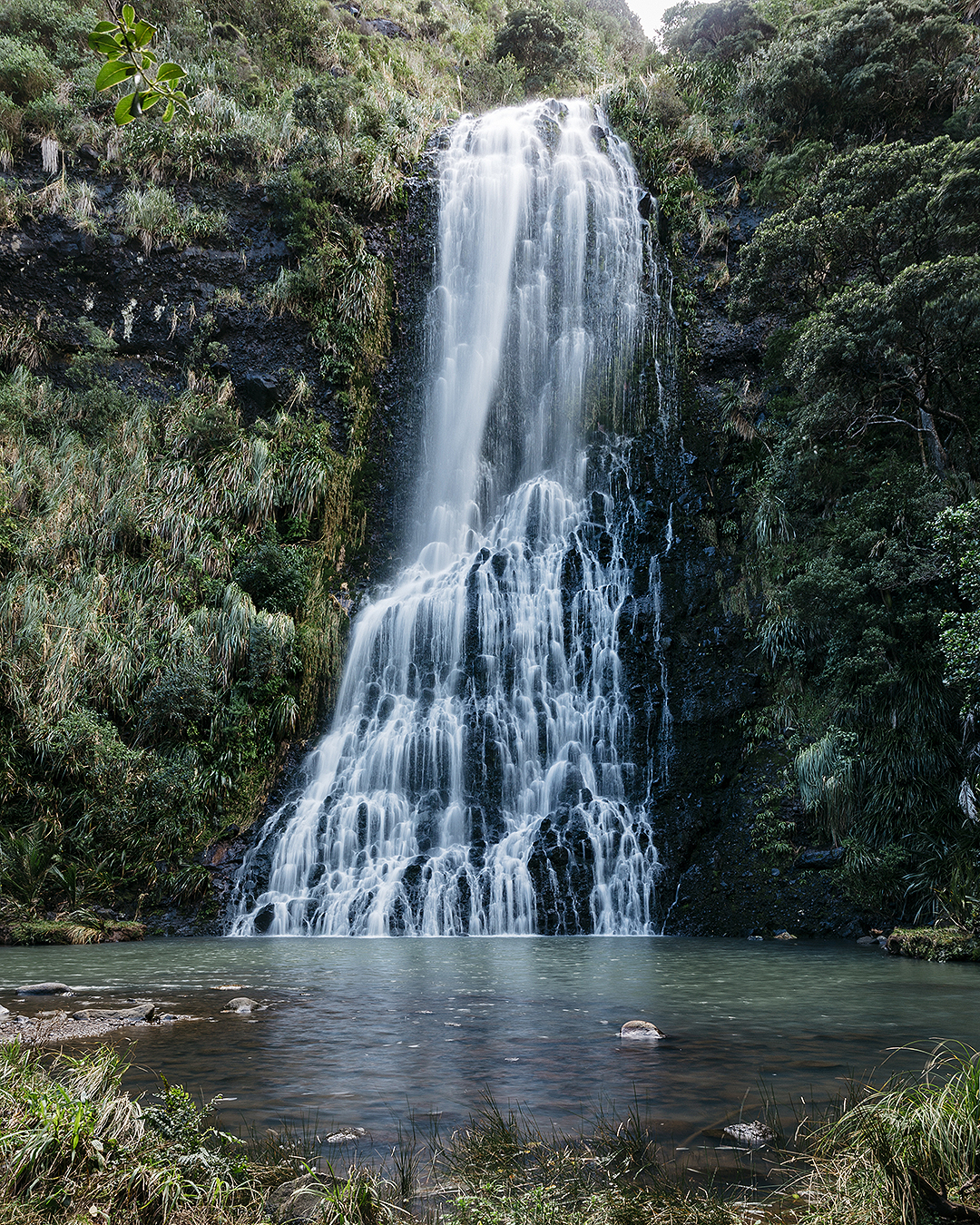 The cascading waterfall at Karekare falls looks beautiful.