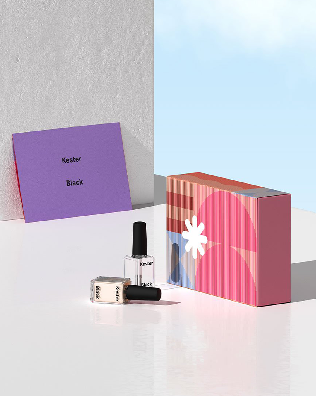 A pink and purple gift box with nail polish from Kester Black