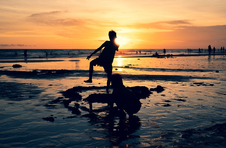 Kids splash about at sunset