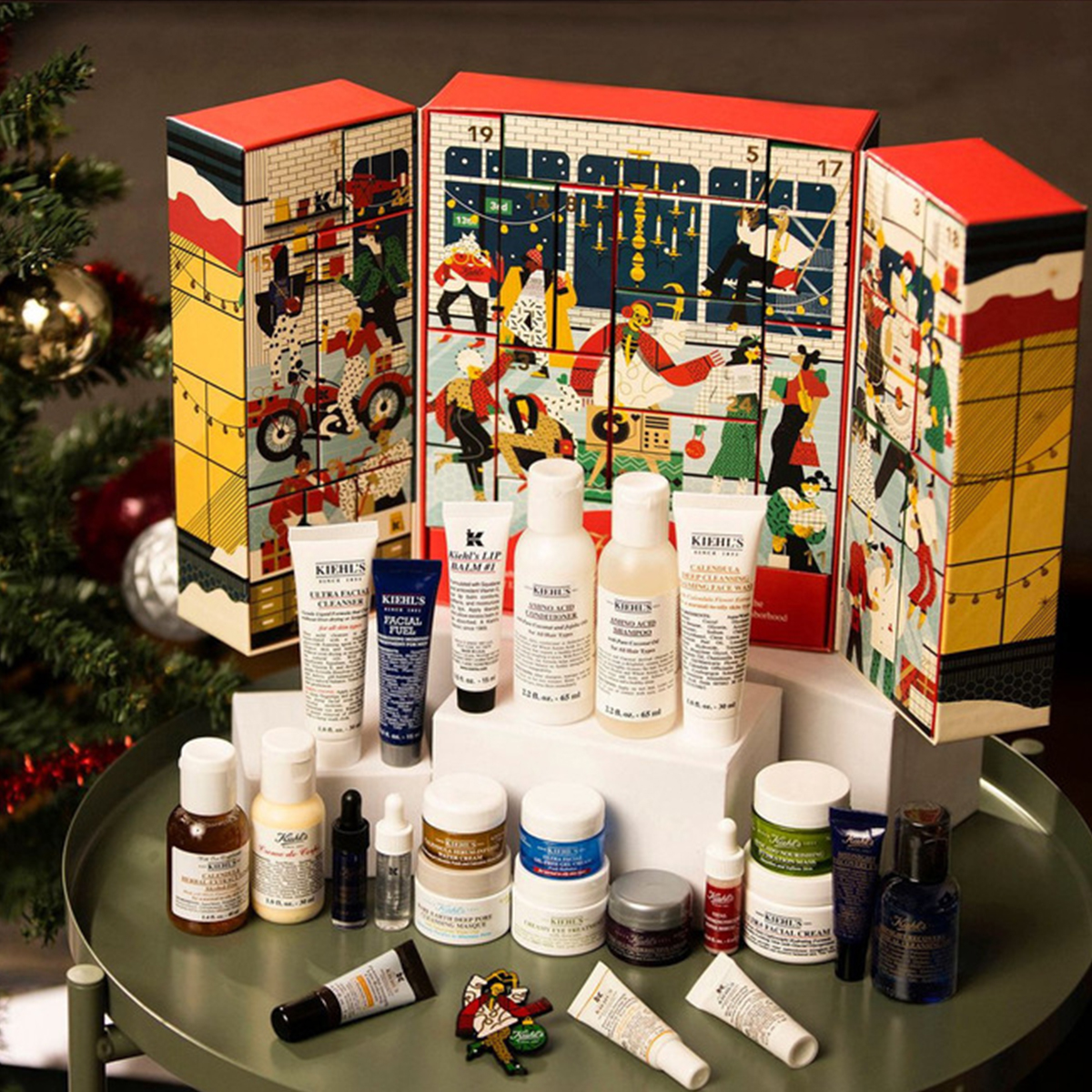an advent calendar with small beauty samples in front of it