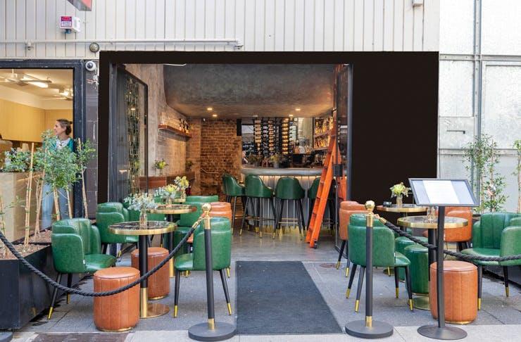 Outdoor seating at Kings Cross Distillery bar in Sydney.