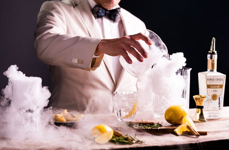 A bartender pouring a Negroni Bianco at the Kings Cross Distillery in Sydney.