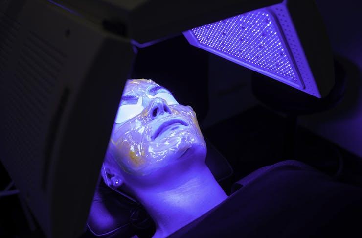 person lies under Kleresca LED lamp