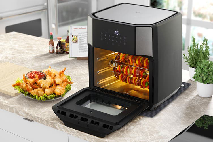 One of the best air fryers under $200 on a kitchen bench next to food.
