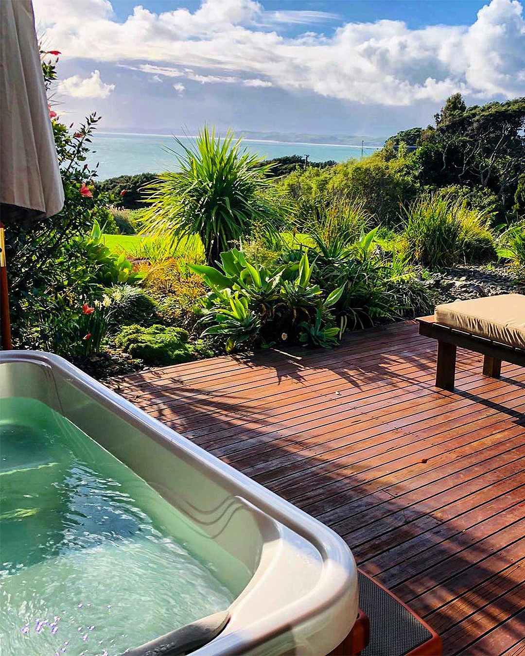 An outdoor hot tub looks out onto a lovely view.