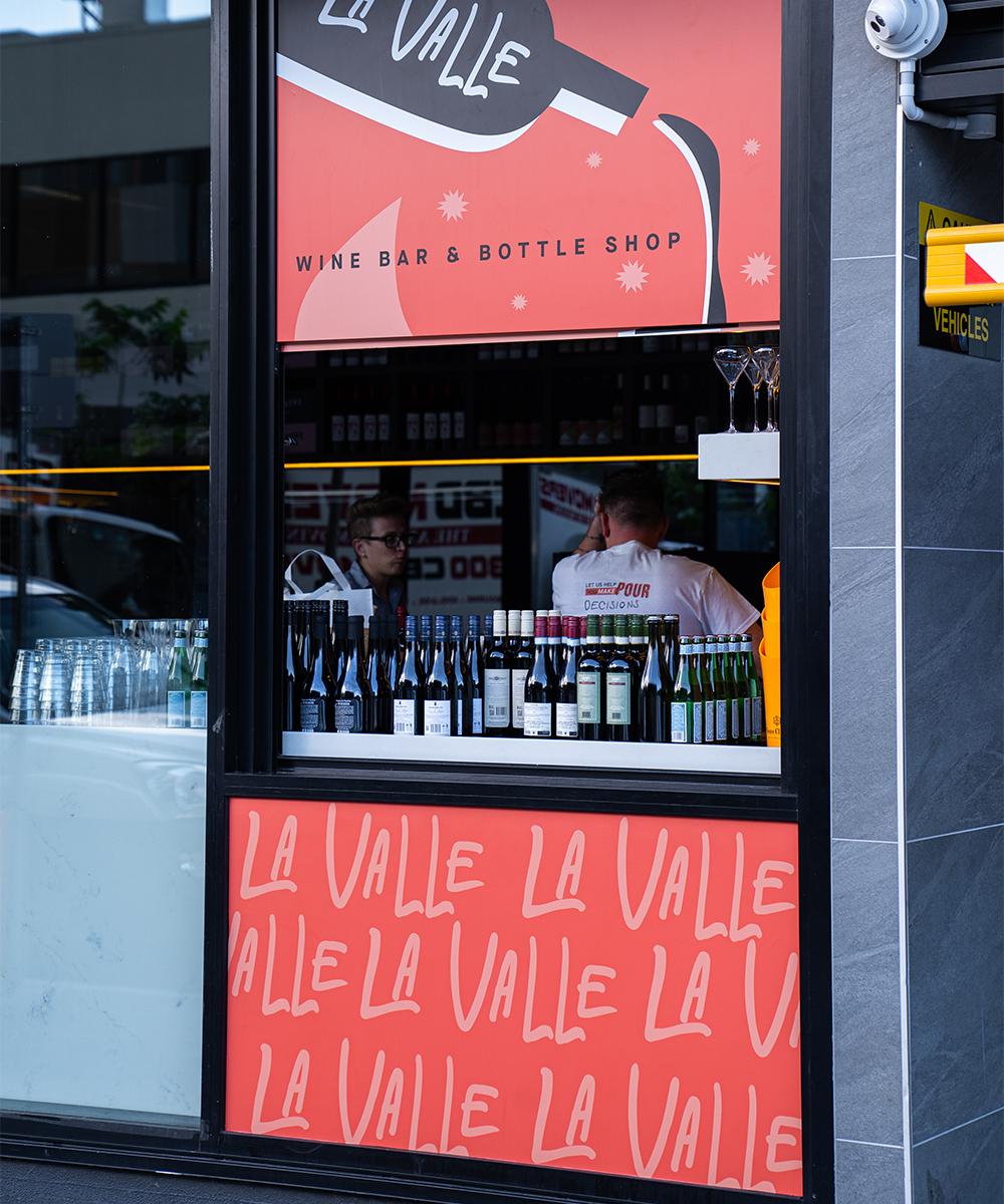 a small takeaway window into a wine shop