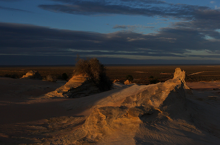The sun setting over Lake Mungo's towering rock formations.