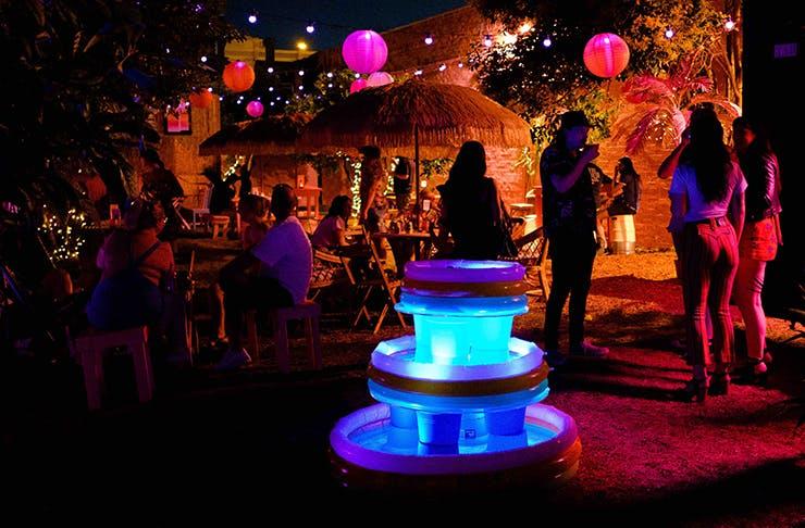 A neon lit 880s style garden bar.
