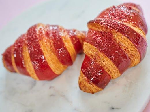 Two raspberry croissants.