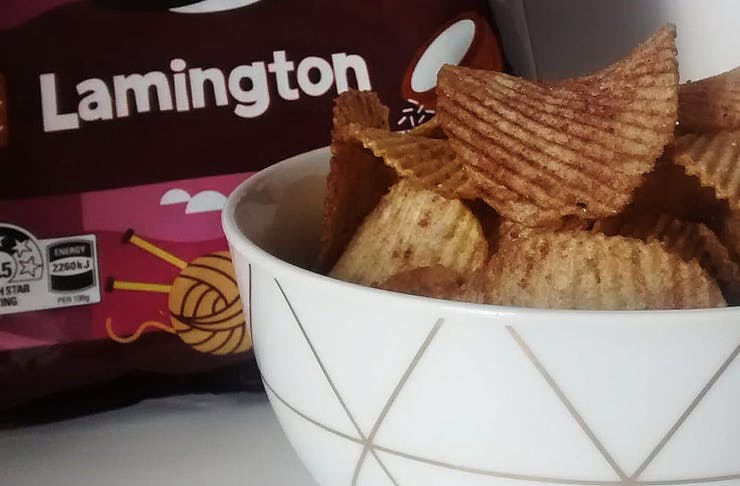 A bowlful of the new Lamington Chips from Bluebird sits in front of the packet.