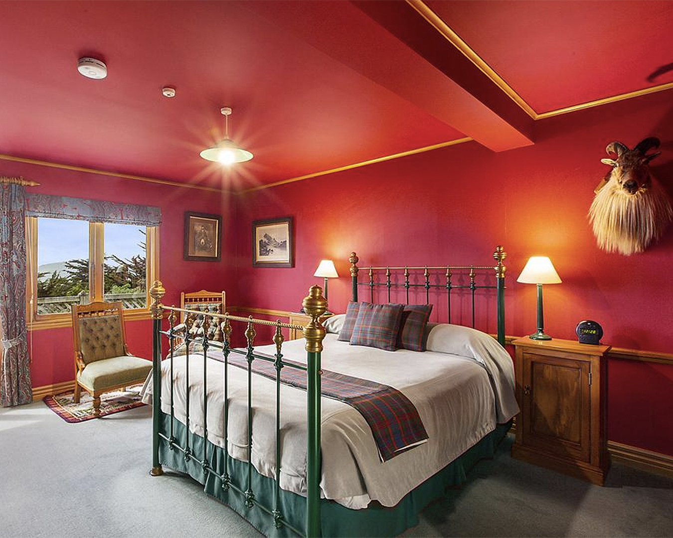 A stately red room at Lanarch Lodge in Dunedin.