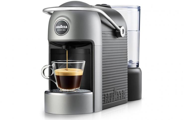 A grey Lavazza home coffee machine.