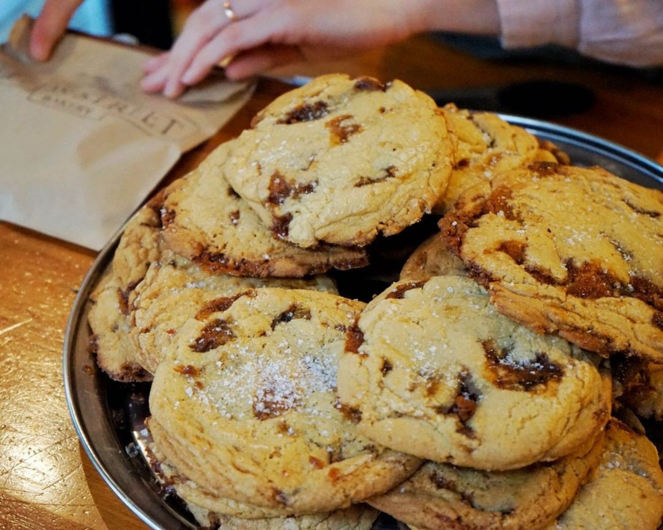 A plate of the beloved Salted Caramel Cookies at Leeds Street Bakery