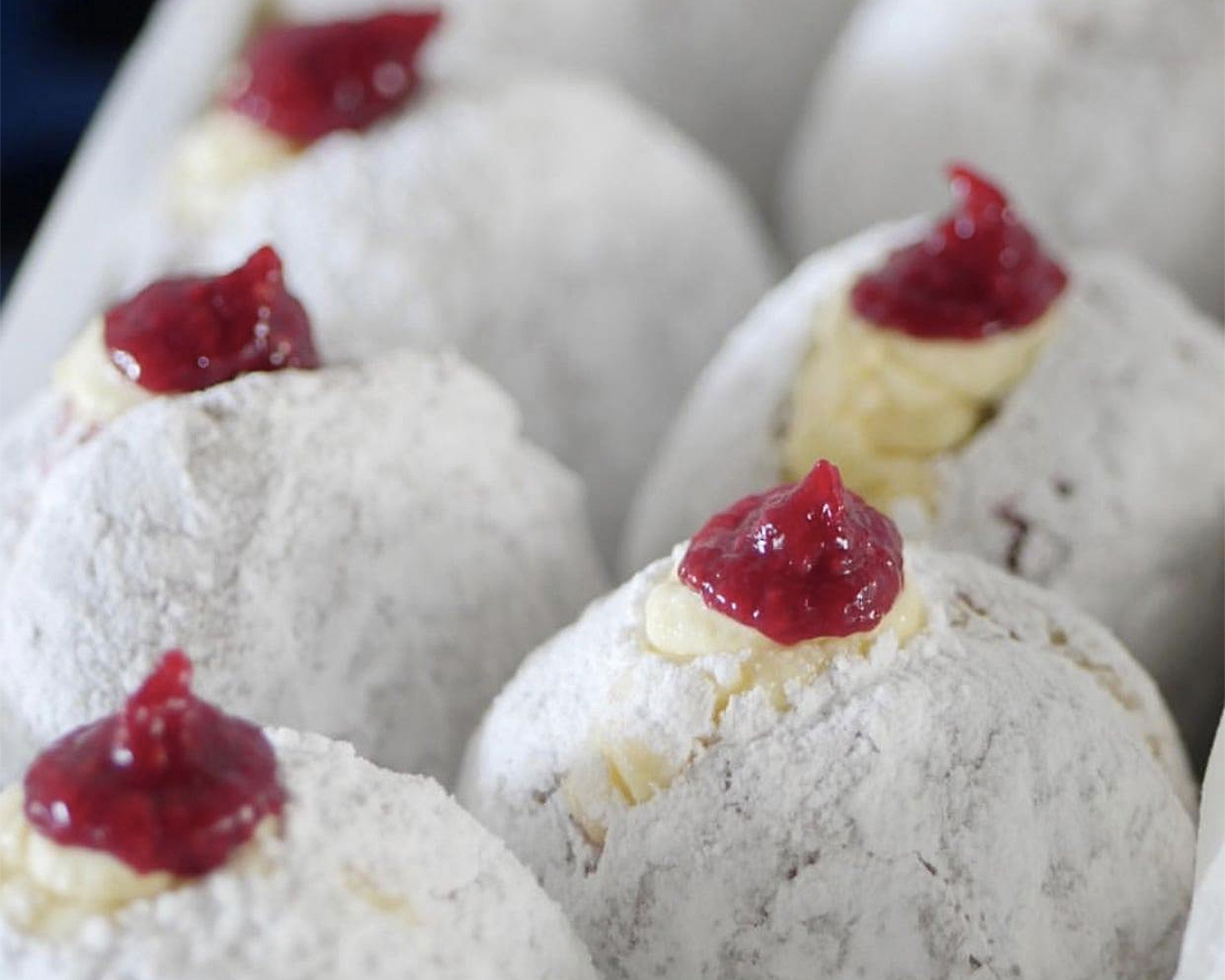 Diplomat donuts bursting with cream and raspberry coulis