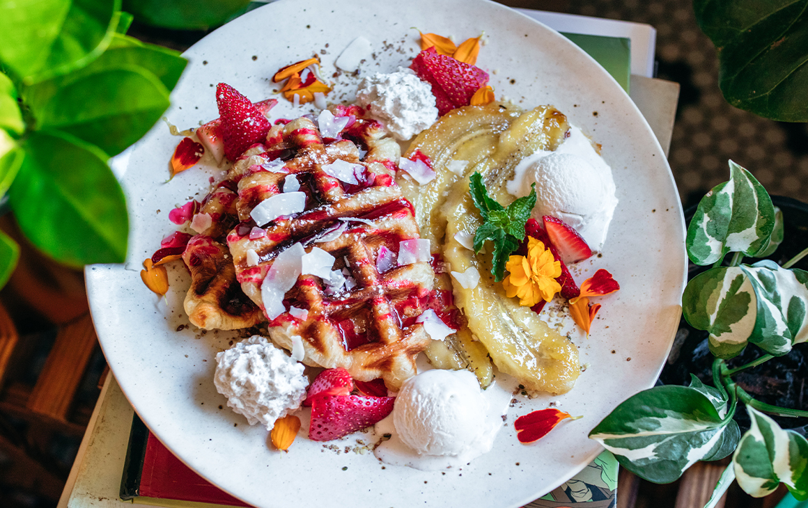a plate of waffles with banana
