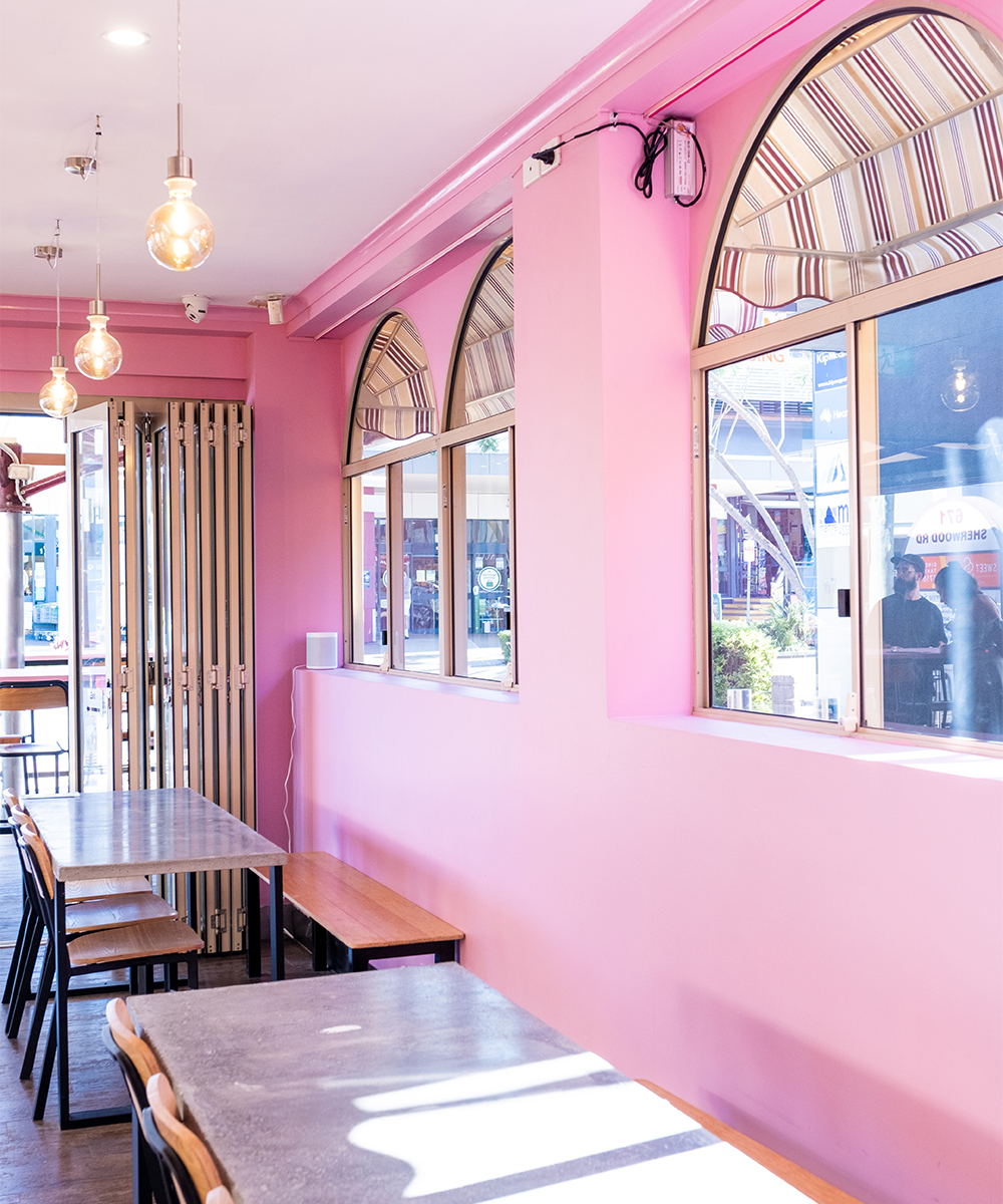 pink interiors and arched windows with awnings at lost palms