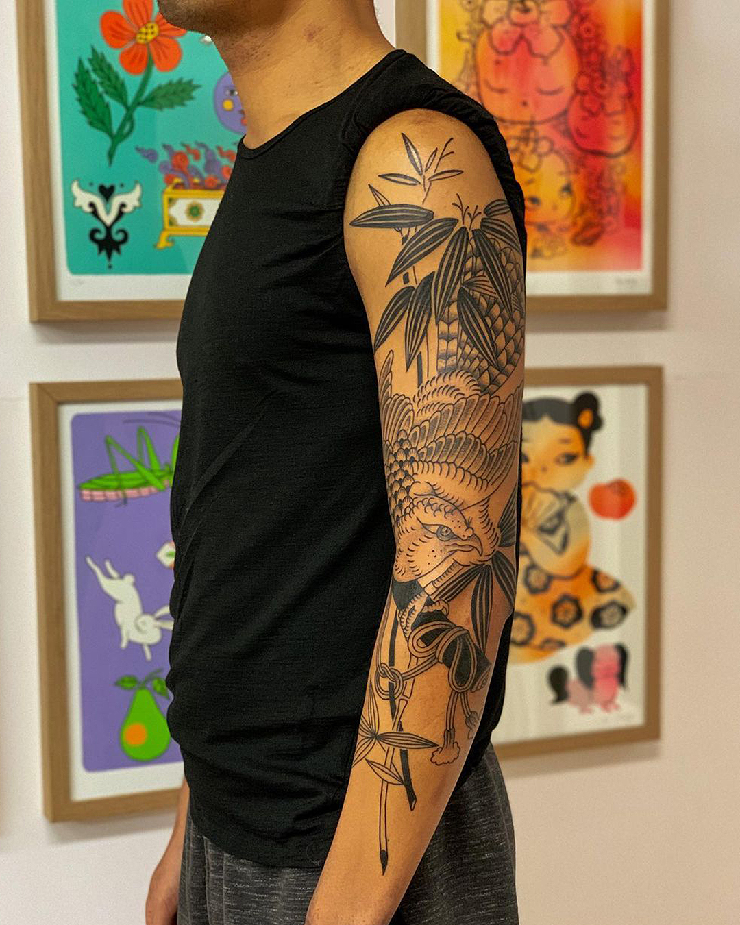 A person displays their sleeve from Love & Hope Tattoo Parlour.