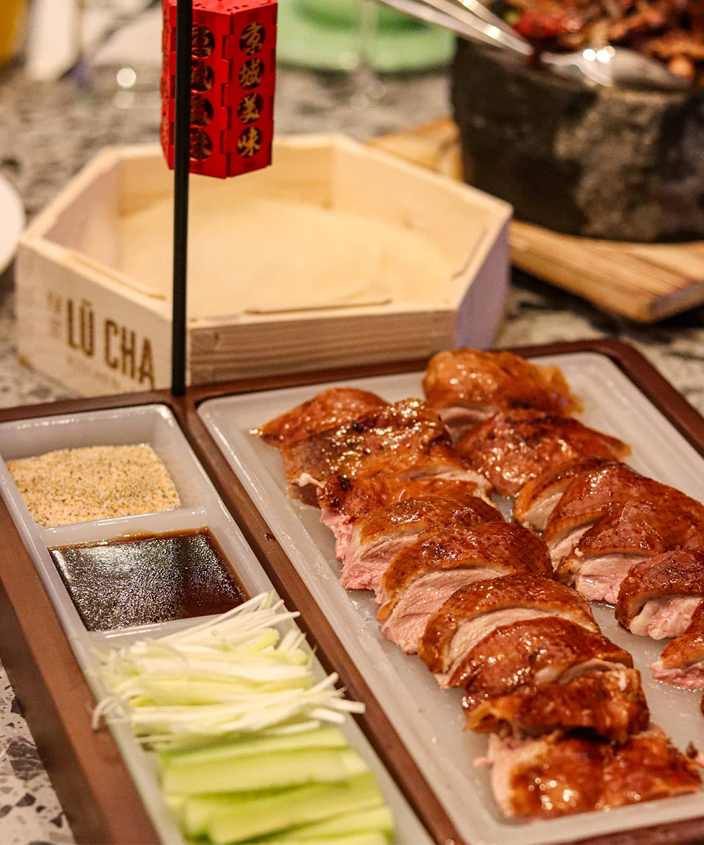 peking duck served with pancakes and sides