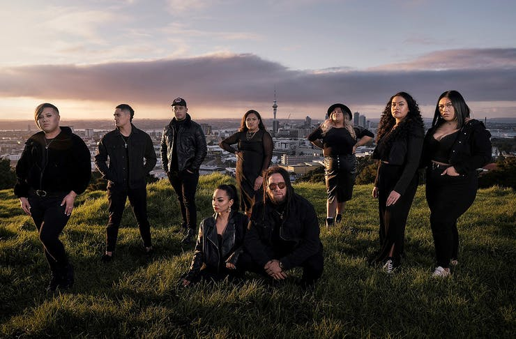 Members of the band Maimoa stand on the top of Mount Eden.