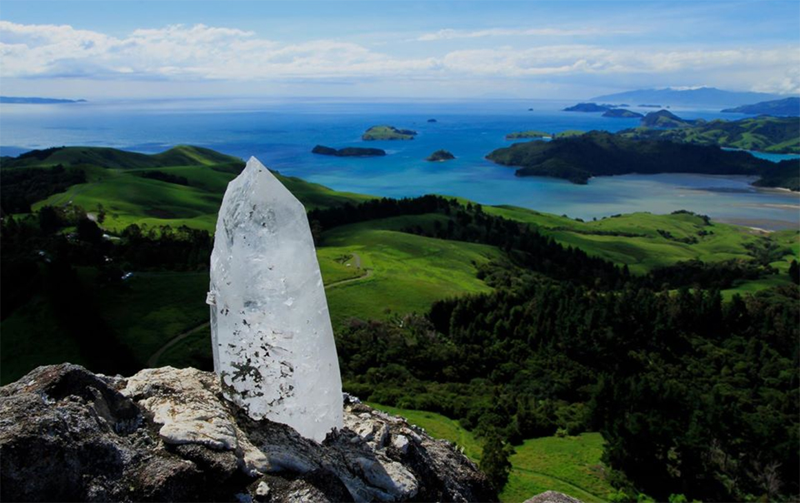 A crystal in the ground in front of an amazing view at Mana Retreat, one of NZ's best retreats.