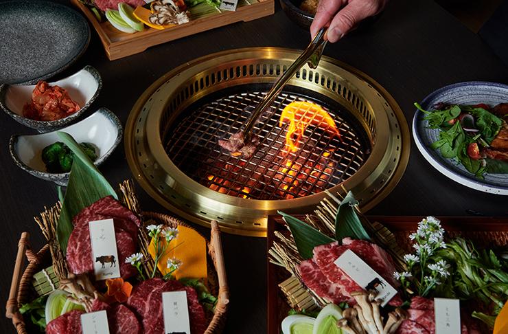 A grill cooking high-grade wagyu steak.