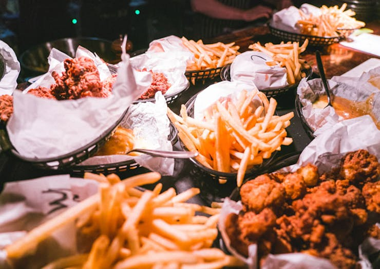 A pile of Mary's Burgers and fries.