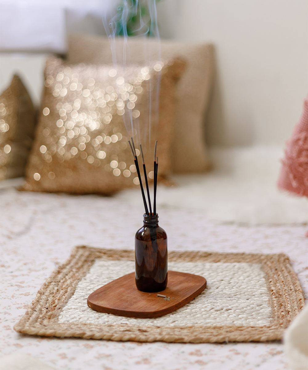 an incense burner on a wooden plate