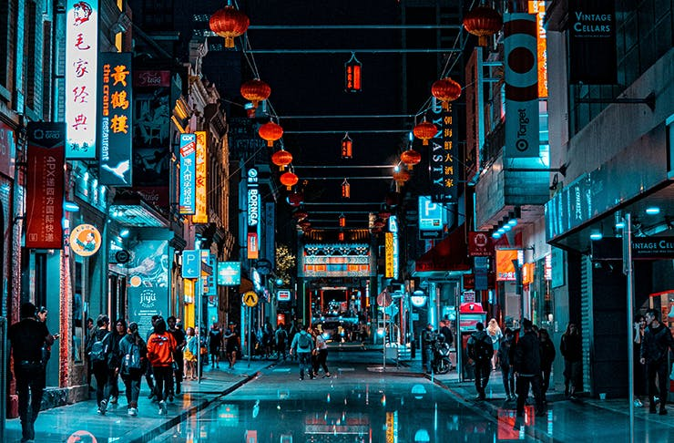 Chinatown in Melbourne CBD lit up at night.