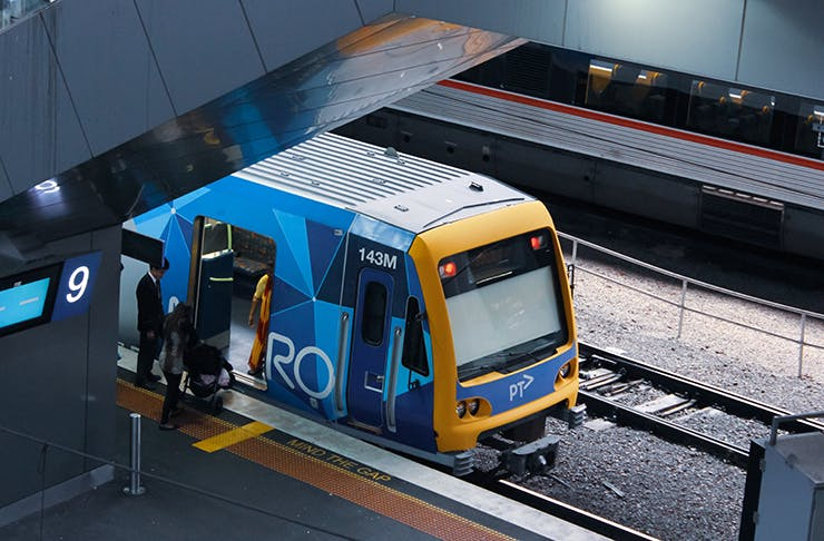 Instant Myki top-ups by a train.