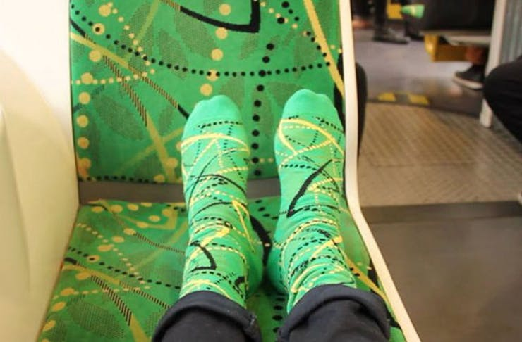 Feet adorning socks in the same fabric as Melbourne's tram seats.