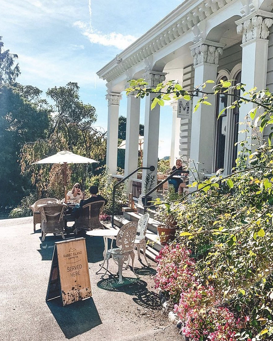 The outdoor seating at Melrose House Cafe on a sunny day