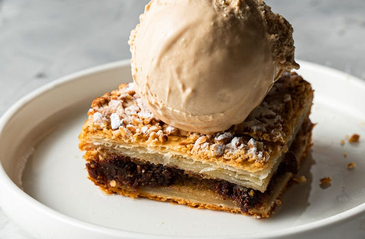 A slice of the Messina galette with a scoop of gelato on top.