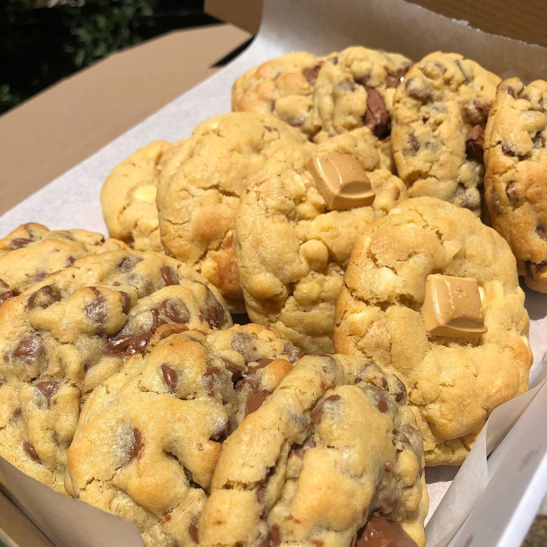 a box filled with caramilk cookies