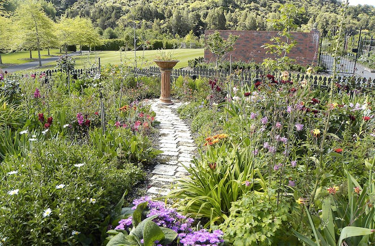A pretty path winds its way along between flowers