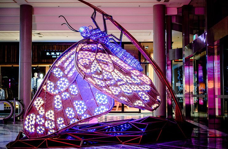 A large purple mechanical butterfly.