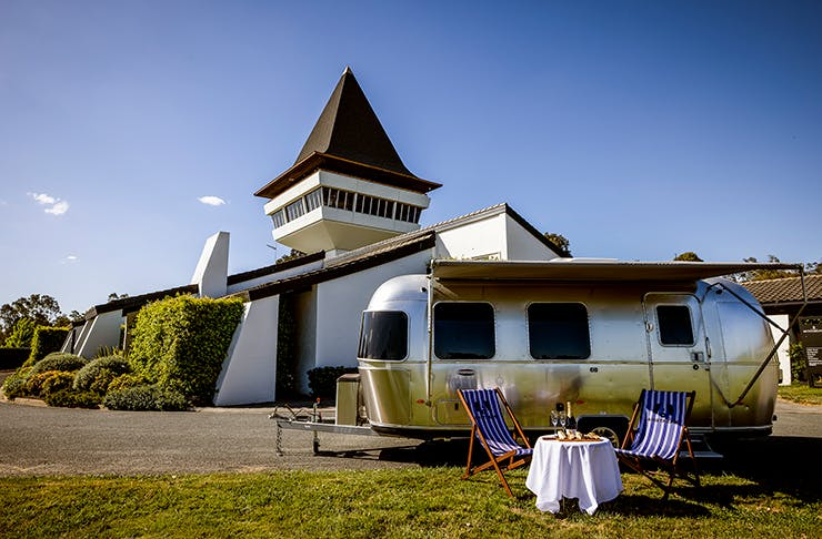 An airstream in front of a winery.