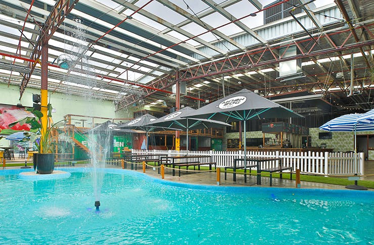 A pool and water feature inside the massive Moon Dog beer hall.