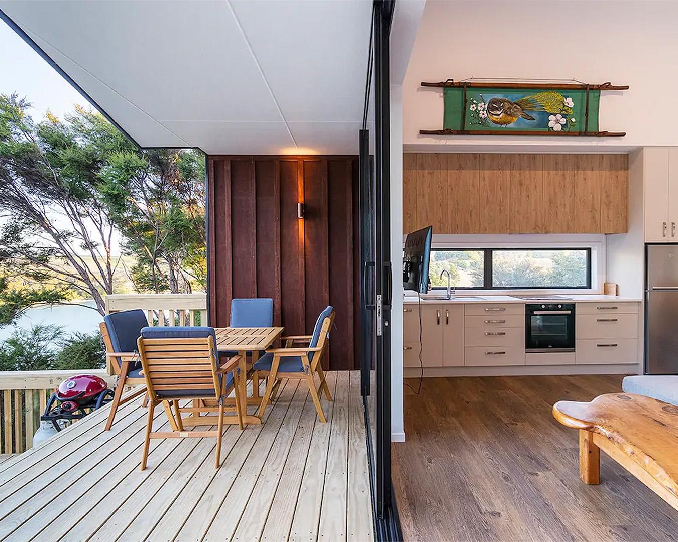 An interior and exterior shot at Moonlight Bay Magic, showing plush furnishings.